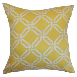 Cotton pillow with a geometric motif.