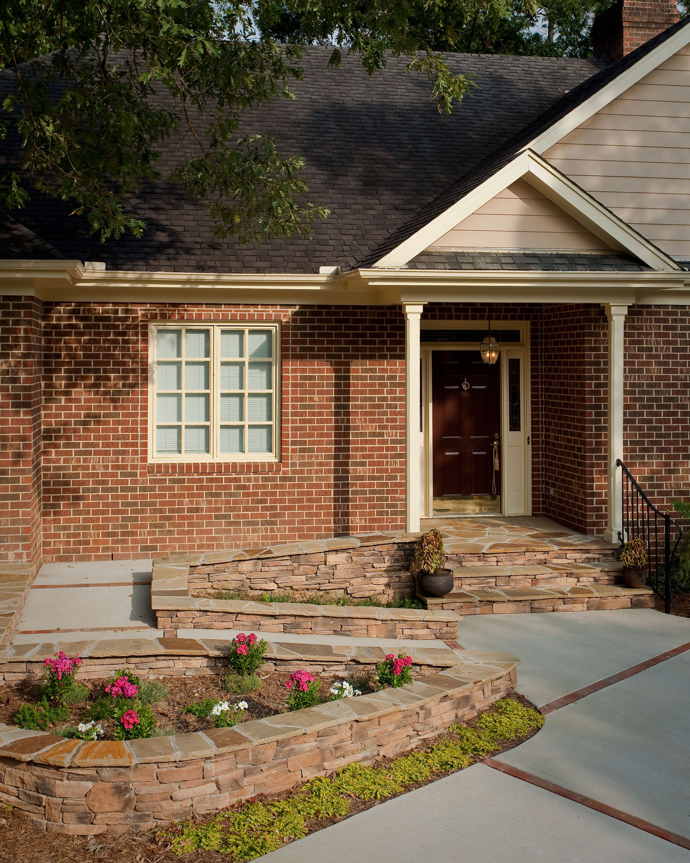 Quality Design & Construction Wheelchair ramp built into the ...