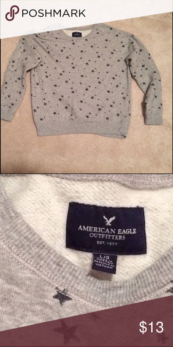 Pull over sweat shirt Light gray with navy blue faded stars on it. Never been worn. American Eagle Outfitters Tops Sweatshirts & Hoodies