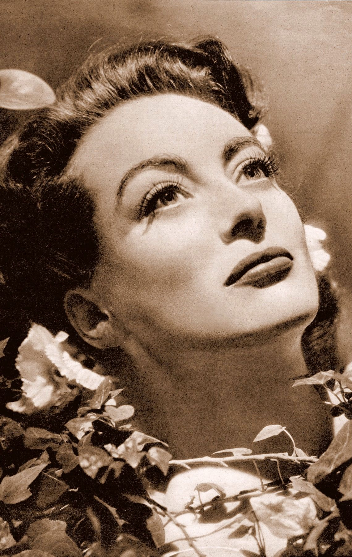 JOAN CRAWFORD pin-up shot (detail) by GEORGE HURRELL in THE SKETCH April 3 1946 vintage clipping. Joan had just won the best actress oscar for Mildred Pierce (1945) (please follow minkshmink on pinterest)