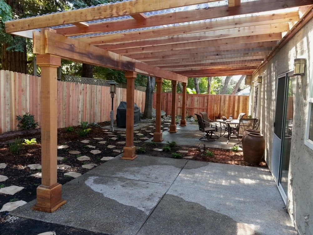 Redwood Pergola With Corrugated Plastic Roof 12 Easy Redwood Garden Pergola Projects To Create Yourself To Complemen Pergola Pergola Plans Building A Pergola