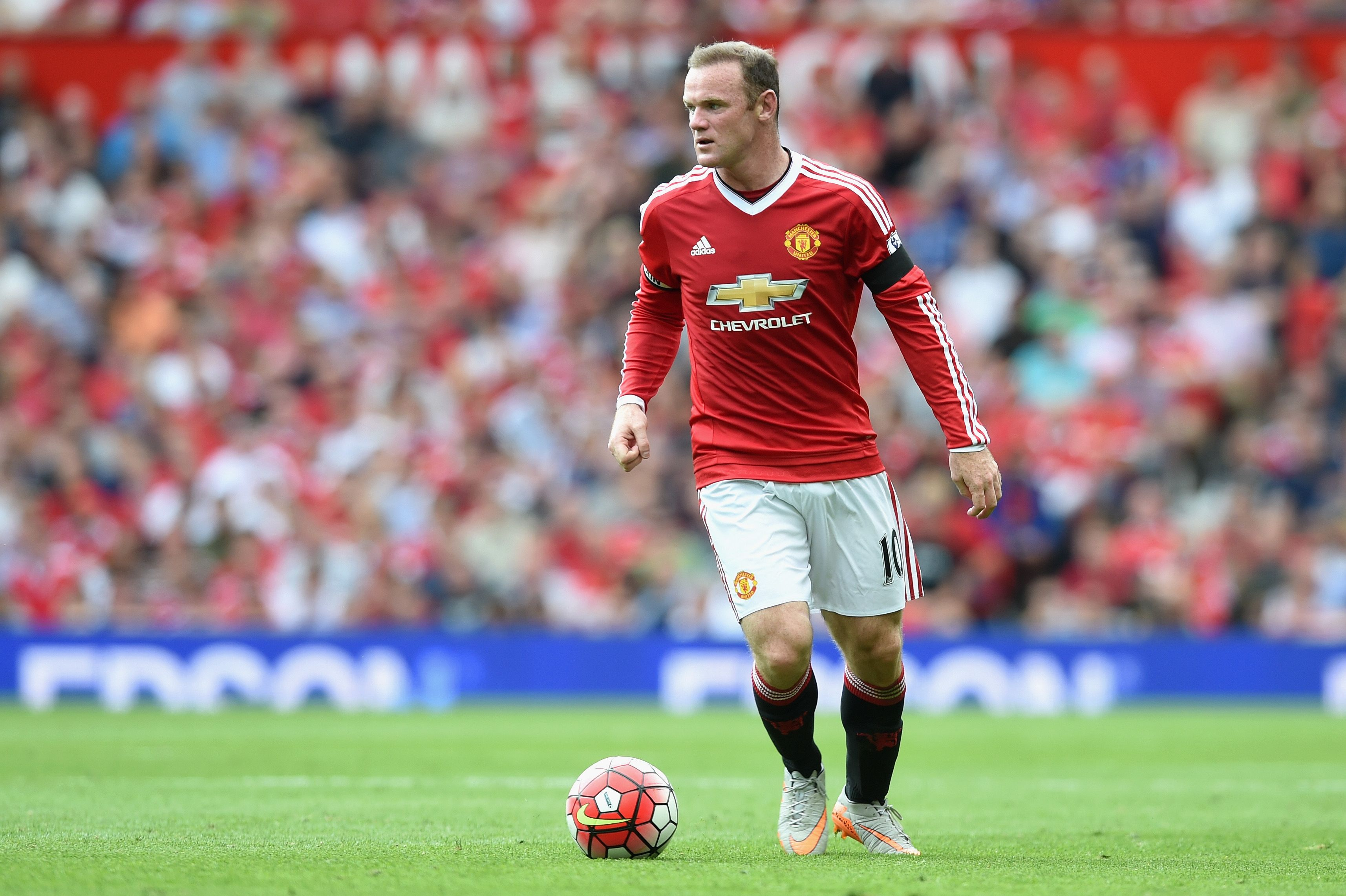 bab6b7e0012 Wayne Rooney captaining United in his first adidas kit.