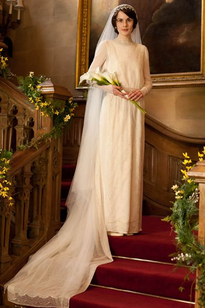 Did you see the Season 3 premiere of Downton Abbey?  Lady Mary's wedding dress was stunning, and true-to-period for the Edwardian 1920s.  The popularity of the show has found its way into this seasons fashion, with romantic flowing and dropped waist design elements.    Spoiler Alert! If you click-though this link you will also get to see Lady Edith's wedding gown (from later in the season).