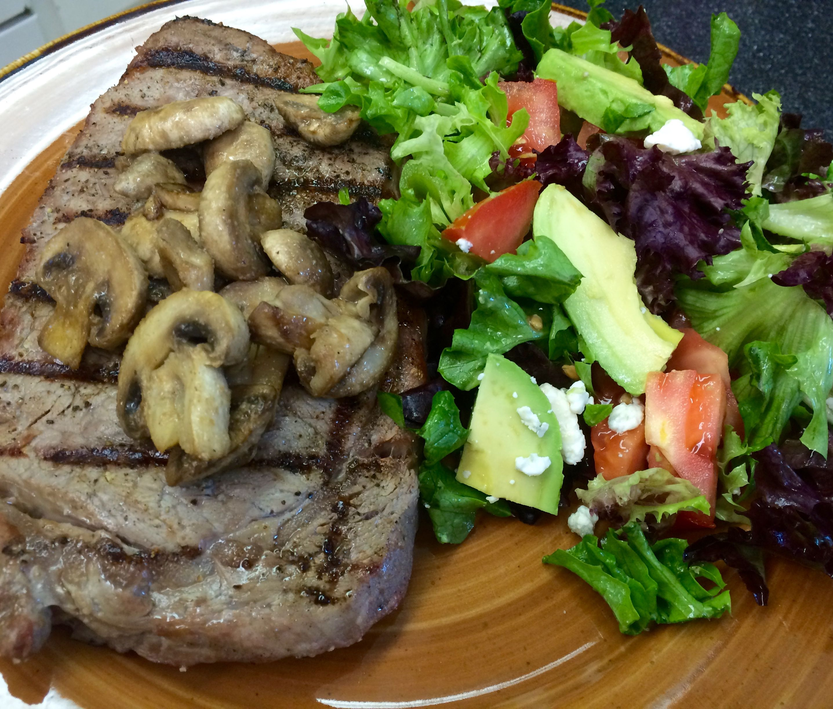 Flame Grilled Steak, mushrooms and fresh locally sourced veggie salad