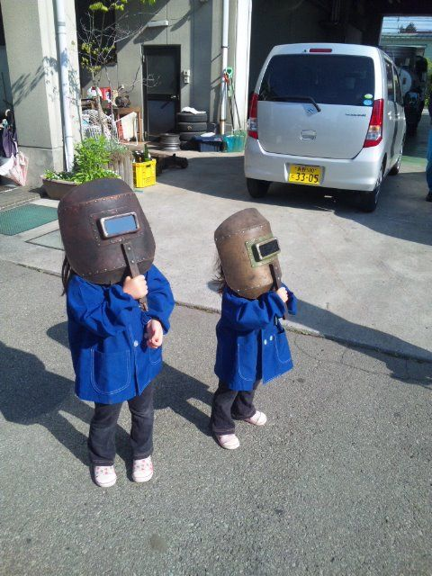 Girls are looking at the annular solar eclipse 2012