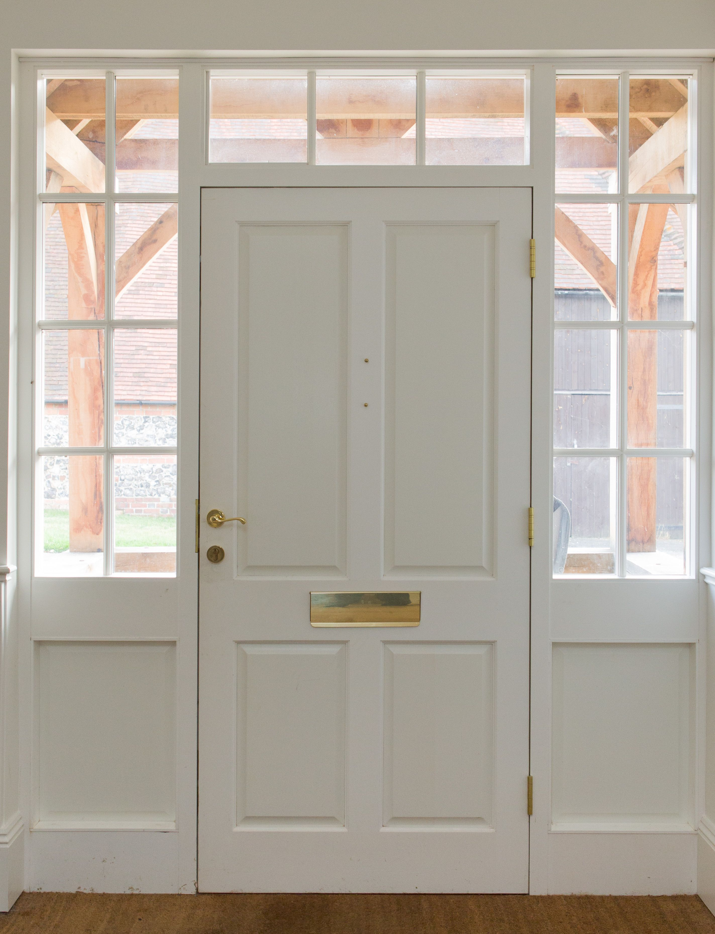 Traditional Four Panel Front Door With Part Glazed Side Lights