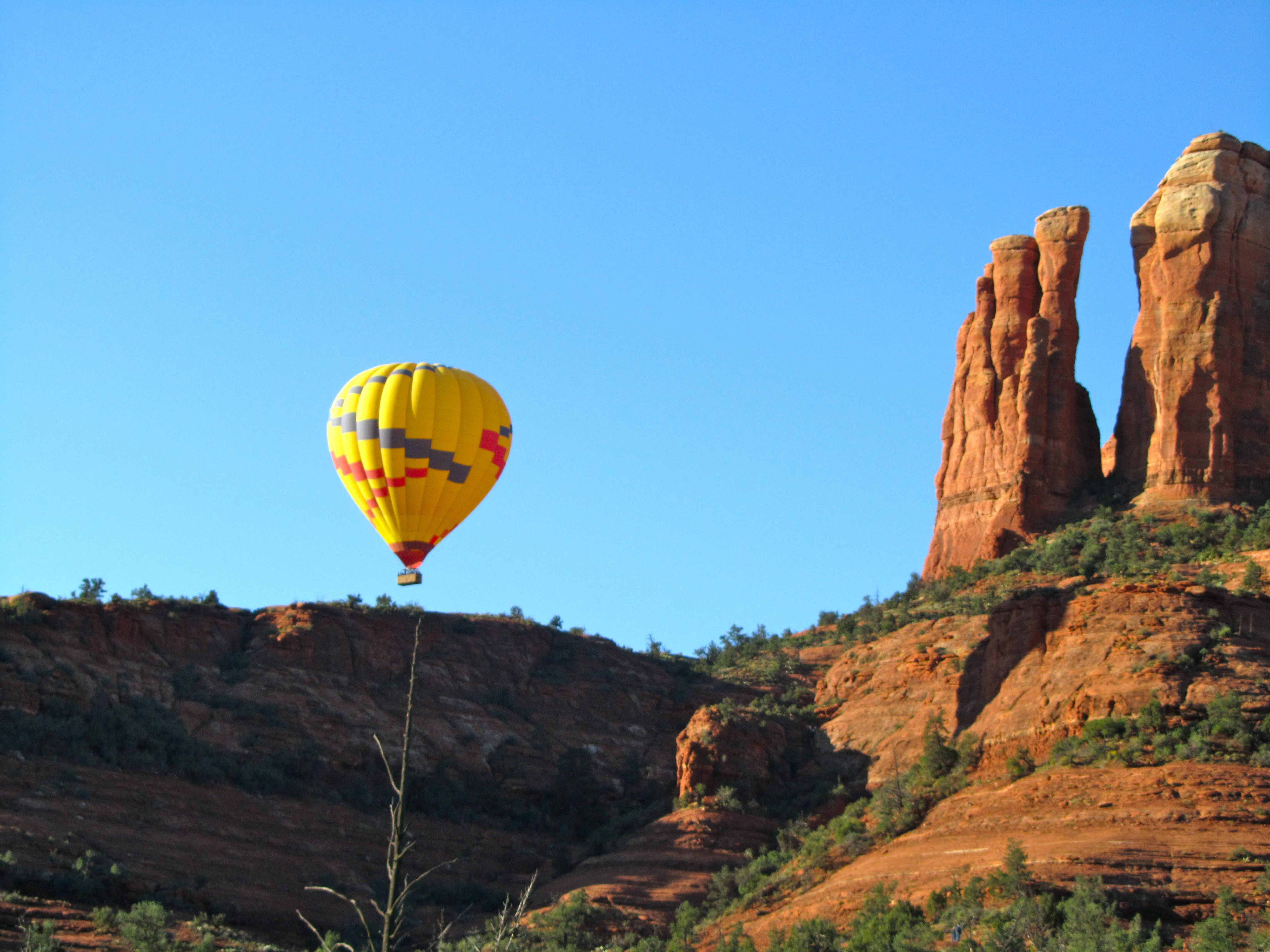 Hot air balloon over Cathedral Rock, Sedona, AZ Places