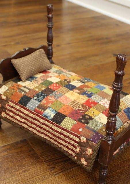 Absolute Favorite. Vintage Doll bed with homemade quilt.