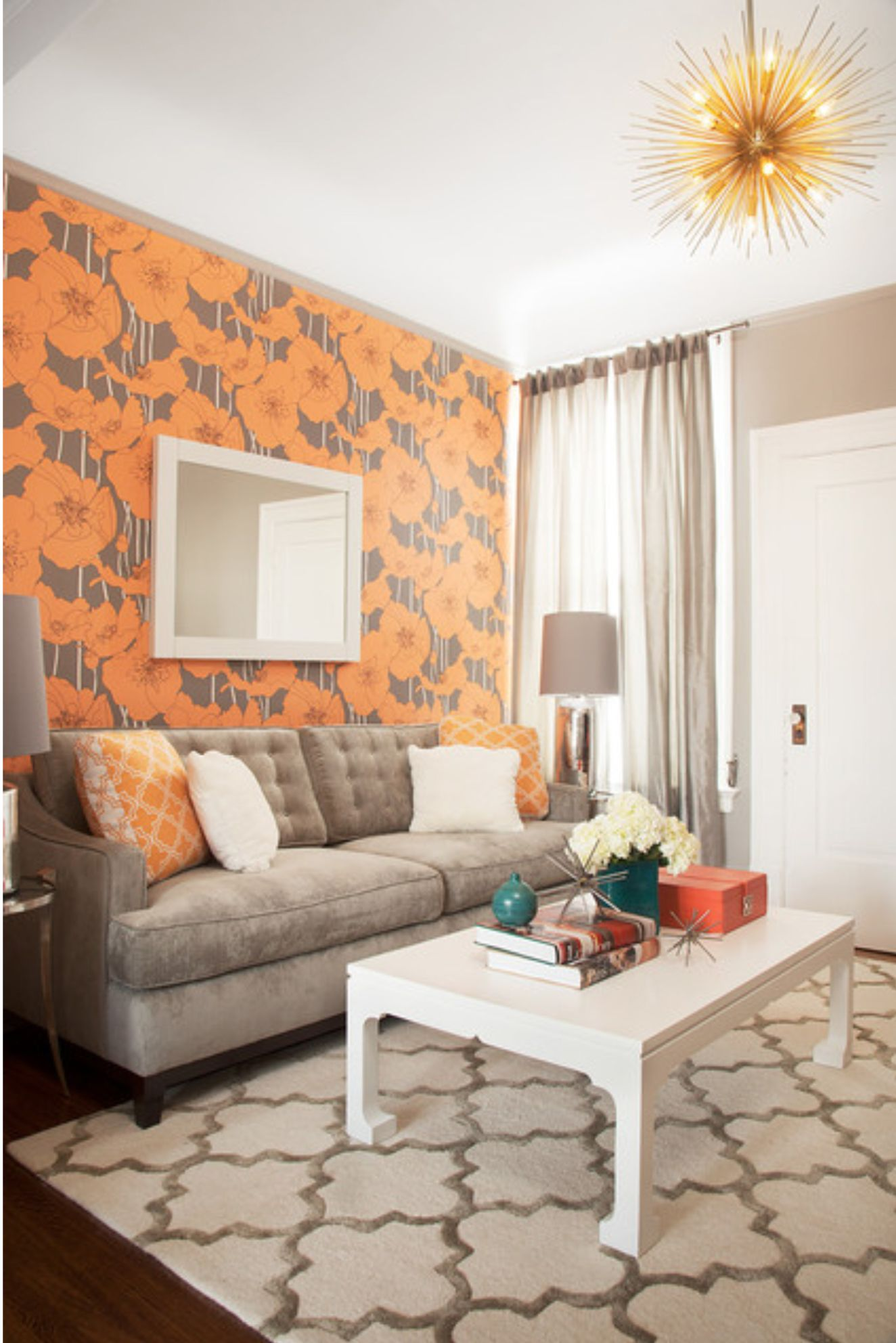 Light grey couch orange and white pillows