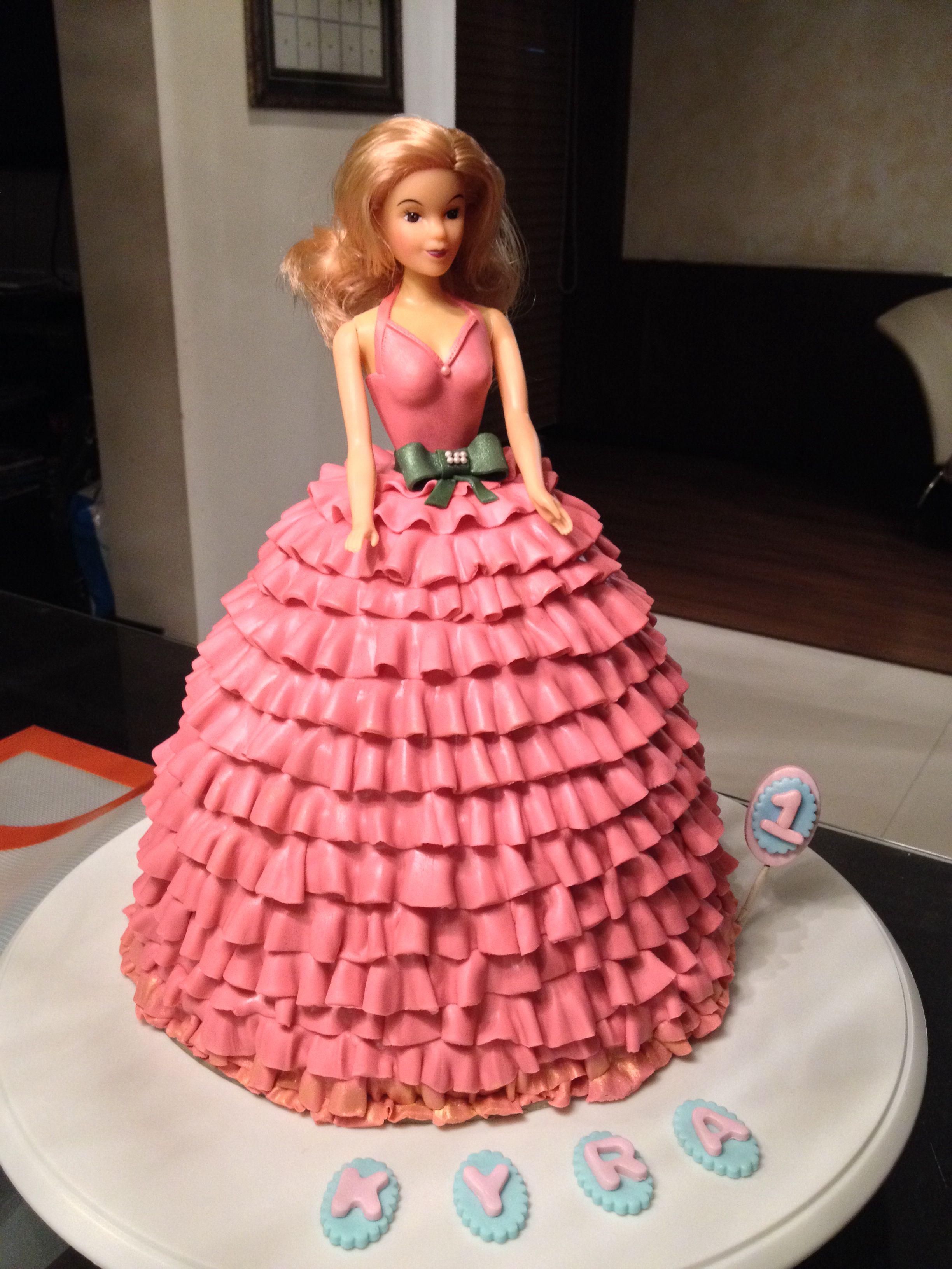 Doll cake. Seven layered chocolate cake with fondant ruffles...