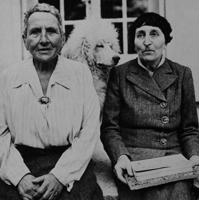 Gertrude Stein and Alice B. Toklas with their standard poodle Basket II