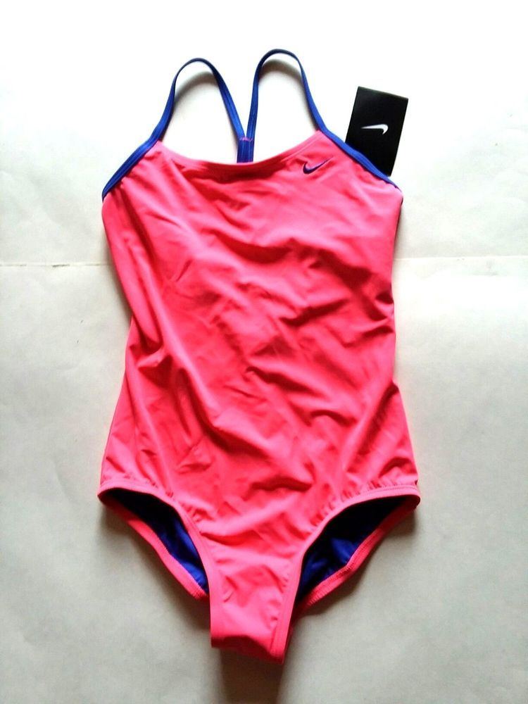 a5755e6622c24 NIKE Girls Core Solid Crossback One Piece Swimsuit. Size Girls 12, 142 -150  cm, average 10-11 years old. Size Girls 14, 150-157cm, average 11-13 years  old.