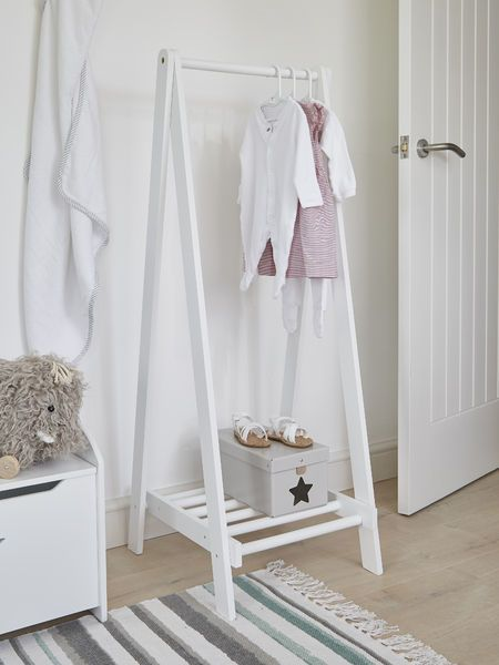 235c2e820502 Timeless and stylish, this lovely wooden clothes rail has been painted in a  smooth white finish making it wonderfully easy to wipe clean.