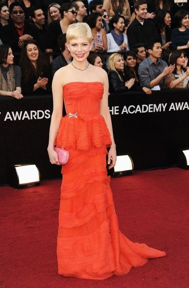 Academy Awards '12: Michelle Williams~ her coral-colored dress was stunning! (she can give it to me now that she's done with it;). The color, the tiers, and the train looked so perfect to me. Love her darling pixie cut too.