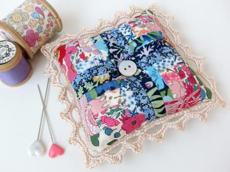 Mini Log Cabin Pincushion | This tiny pincushion project is a great way to use your quilting scraps!