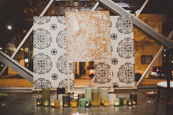 gorgeous ceremony backdrop with fabric + candles // photo by StudioCastillero.com