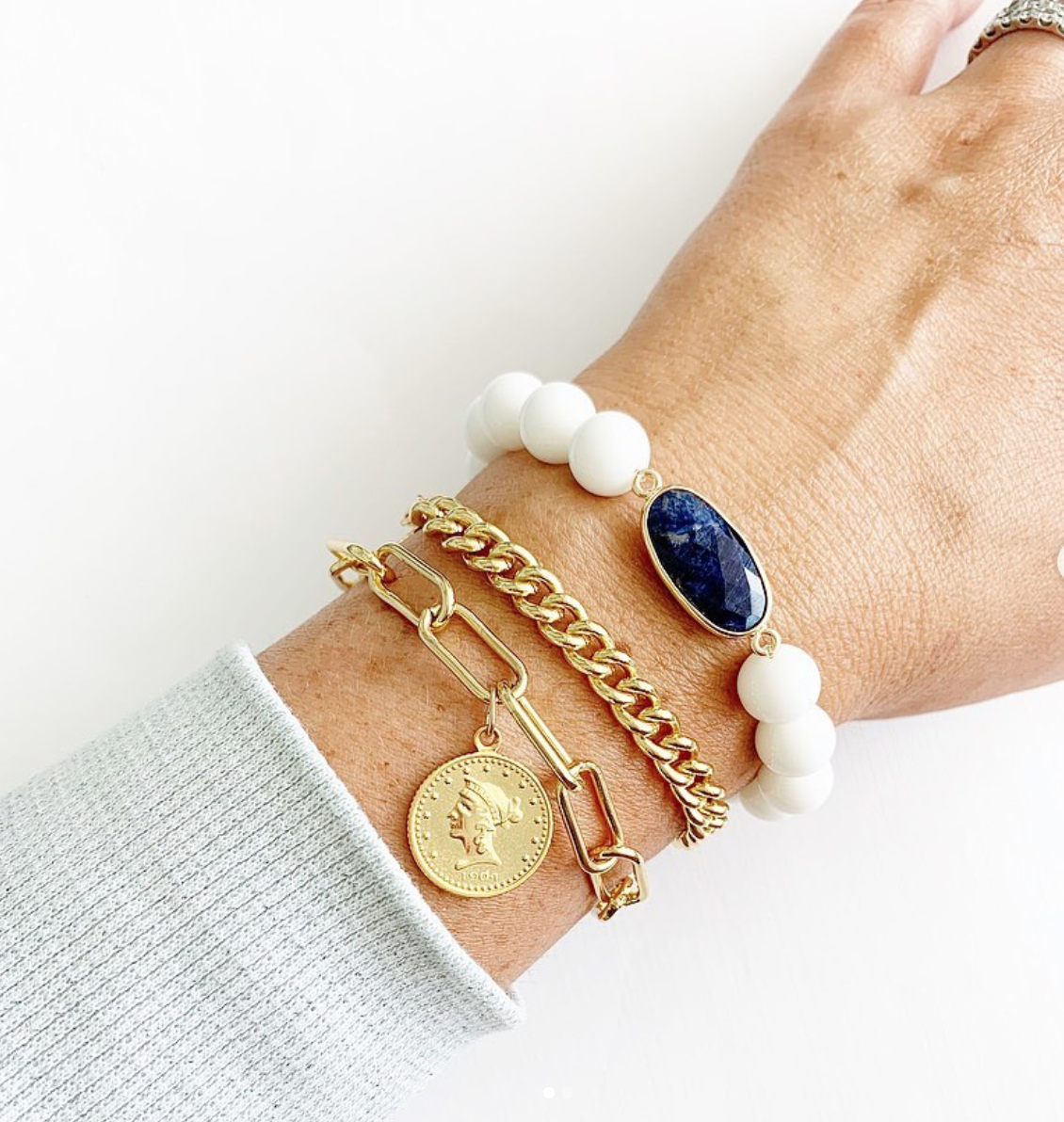 Our signature 14k gold chain bracelets with our signature pendant and our gemstone bracelet pair perfectly together in this boho inspired bracelet stack! #bohoinspo #bohostyle #goldjewelry #jewelryinspo #boholove #bohojewelry
