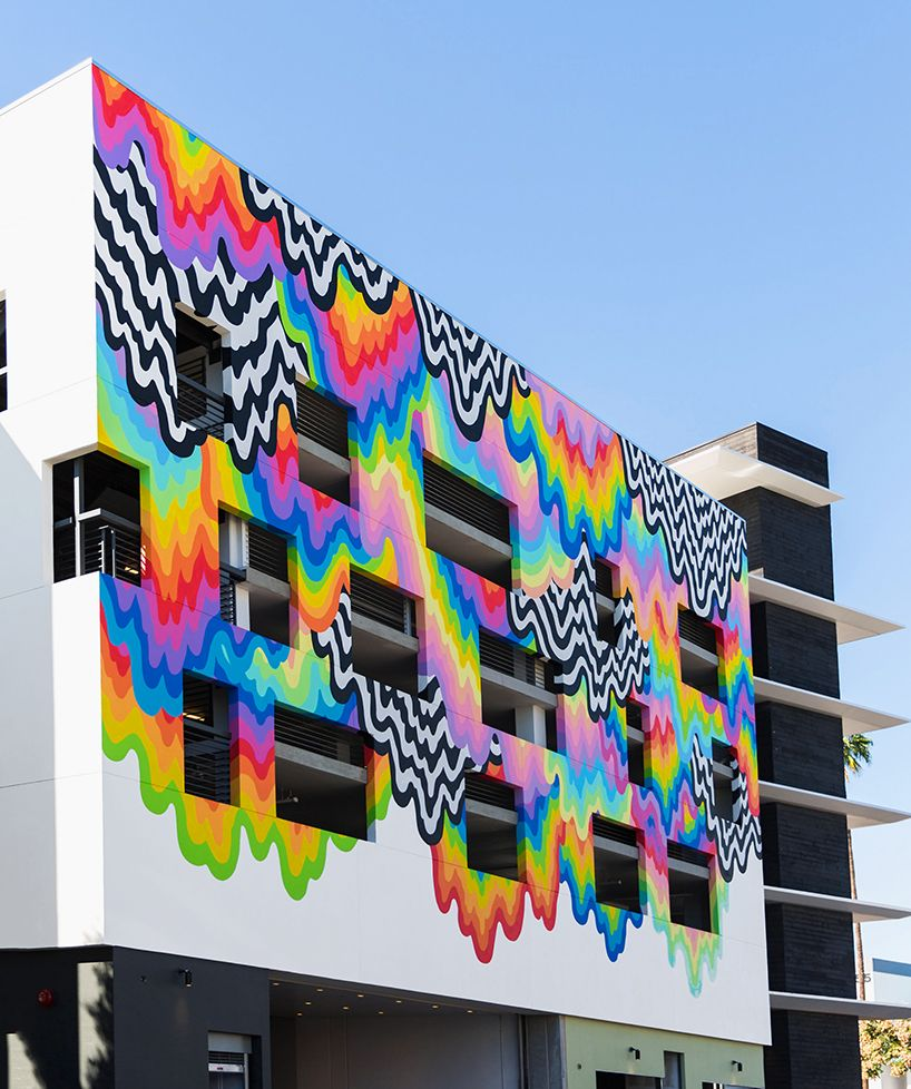 Emblazoned across the flagship location of platform is technicolor ooze a drippy and trippy mural by los angeles based artist jen stark