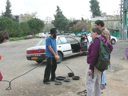 Blow torching pans for Pesach, Jerusalem