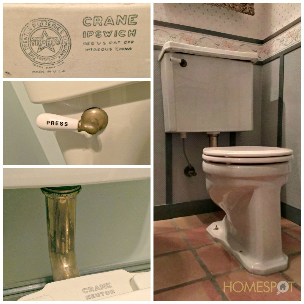 Antique toilet with brass connections and a porcelain handle ...
