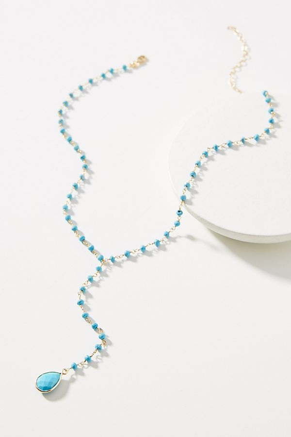Jemma Sands Crosby Gemstone Lariat Necklace by in White Size All, Jewelry at Anthropologie is part of Gemstone lariat necklace, Gemstone lariat, Lariat necklace, Gemstones, Lariat, Women accessories jewelry - Try outfitting this gemstone lariat with a Vneck silhouette to really let it shine About Jemma SandsJemma Sands jewelry was created by Jennifer Heim, a Californian native who finds inspiration when she surfs  Aiming to share her love of the open water, Jennifer handcrafts her bracelets, necklaces, and earrings using translucent gemstones reminiscent of the local sea glass she collects along the Pacific shoreline  Calming color schemes makes it easy to layer your favorite pieces for a timeless, bohochic style