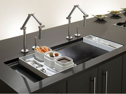 Large double-faucet kitchen sink could service two work areas... a ...