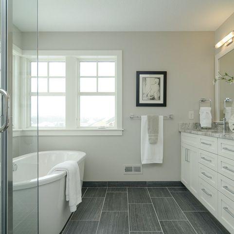 white vanity, long dark grey tiles, nice deep tub. very