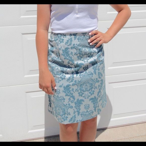 """Blue High-Waisted Skirt This gorgeous skirt is in perfect condition. Never worn! Lovely blue hues with a subtle sheen will be sure to catch the eye and show off that waist! Waist measures 26"""", waist to hem measures 21"""". Feel free to ask any questions or make an offer! Skirts"""
