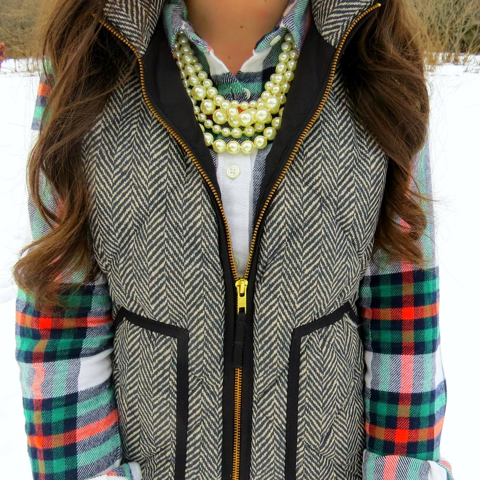 Love the flannel/vest/pearl combination! The different sizes of pearls makes it a really unique look
