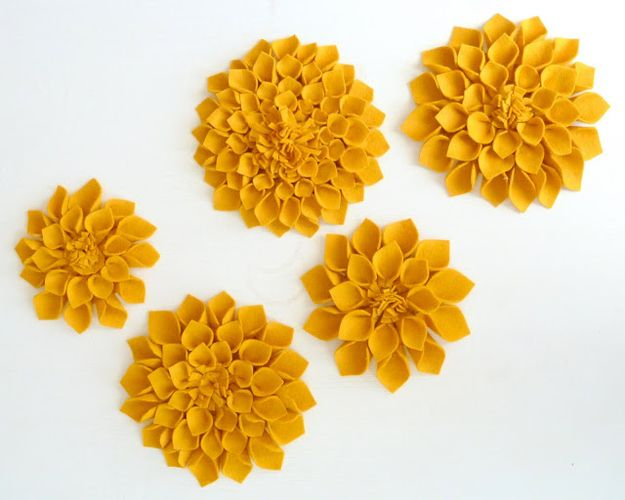 23 projects for you and hot glue pinterest felted flowers felt flowers you make them petal by petal but theyre pretty simple theyd be pretty as a wall decoration glued to a pillow or hung on a door tutorial mightylinksfo