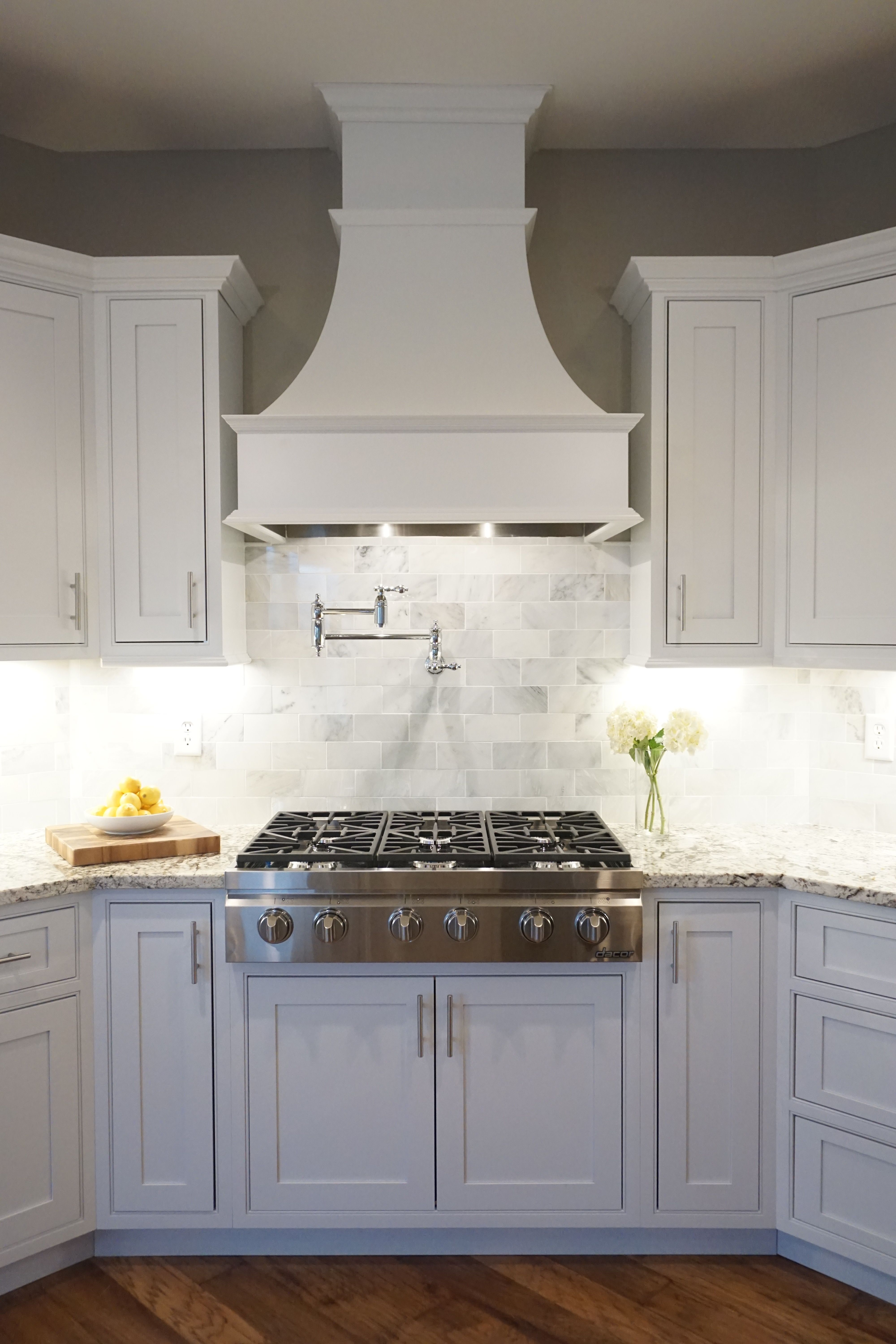 White cabinets shaker door inset cabinetry decorative for Decorative stove hood