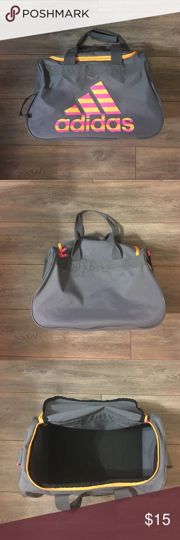 Ladies Adidas gym bag Pink and orange adidas gym bag with gray body. Not a huge  bag d633e5f37277d