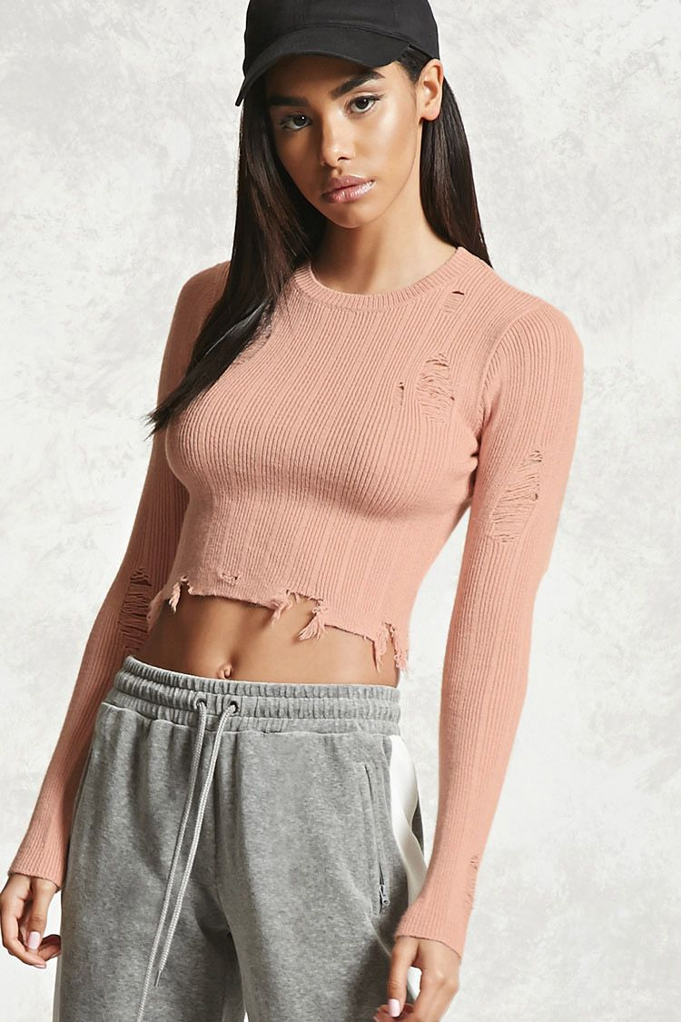 24ae1c06c29fa7 A ribbed knit cropped sweater featuring an allover distressed style