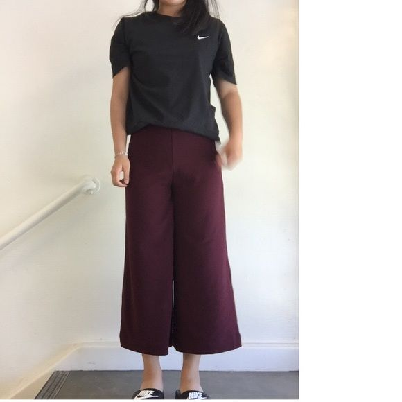Kimchi blue burgundy wide leg culottes pants Size 2, runs big. I'm a 27 and it fits fine. New with tags, too many pants like this . You can wear a cute crop top or fancy shirt with it or just style it with a simple tee. Super chic ( and it's comfy too Urban Outfitters Pants Wide Leg