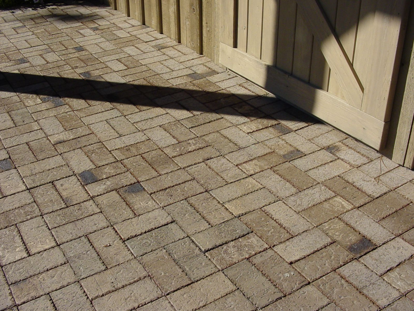 This Tan Neutral Toned Paver Brick Patio In A Basket Weave Pattern Was Created
