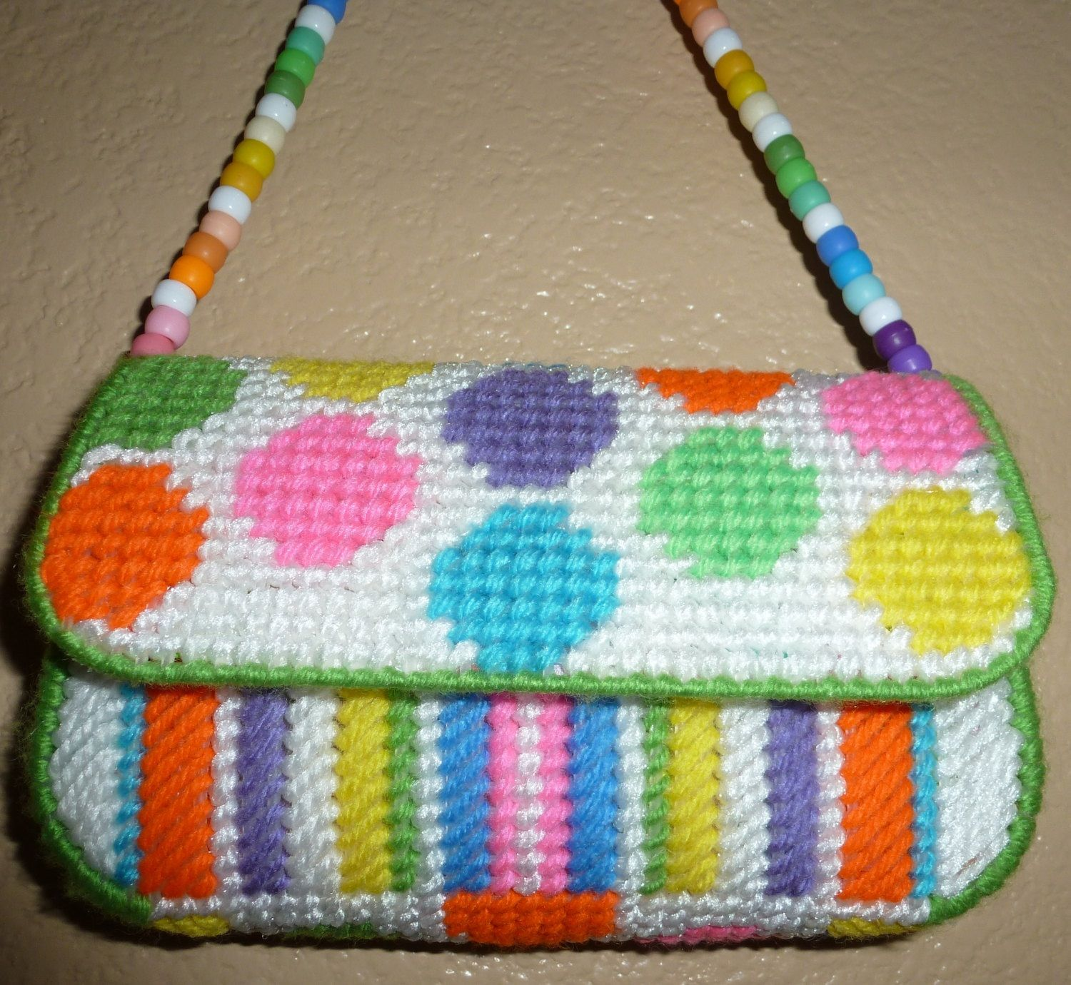 I love the colors and pattern on this... The strap is really cute ...