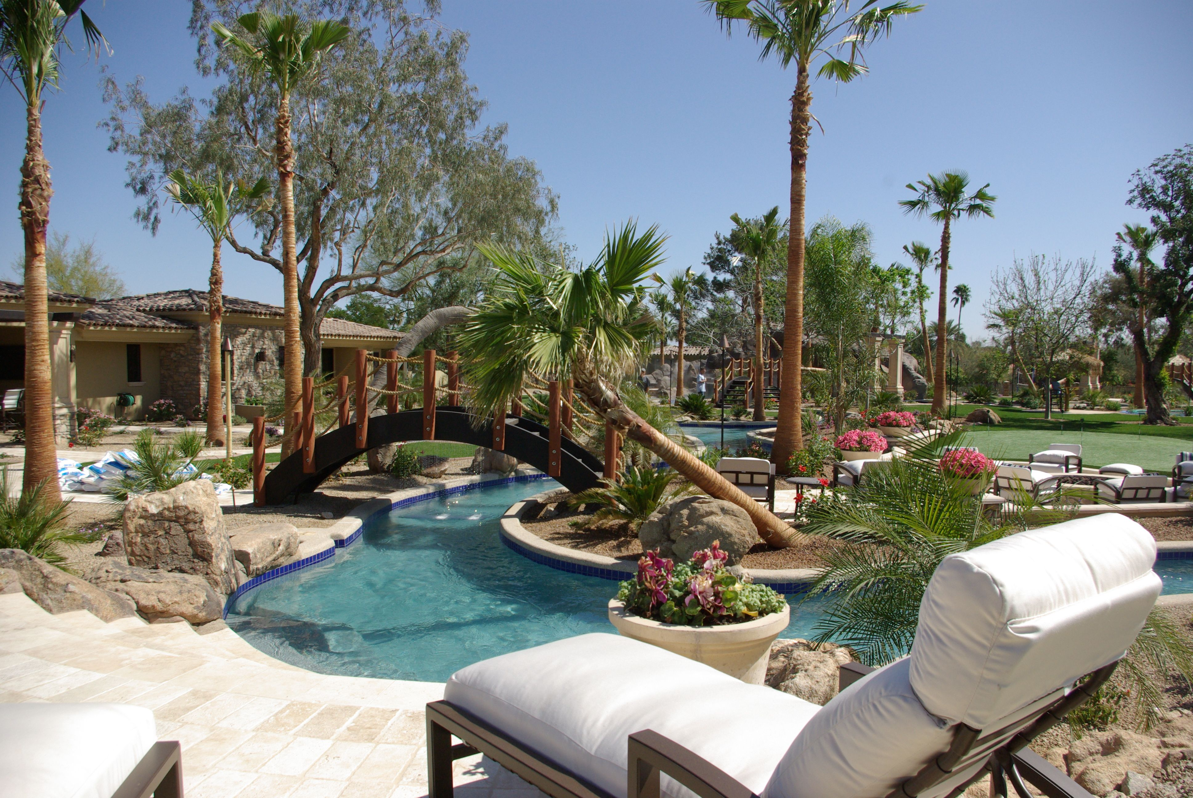 Luxury Lazy River Designed And Built By Mossman Brothers Pools In Scottsdale Az The Current In The Lazy River Is P Backyard Pool Indoor Outdoor Pool Swim Spa