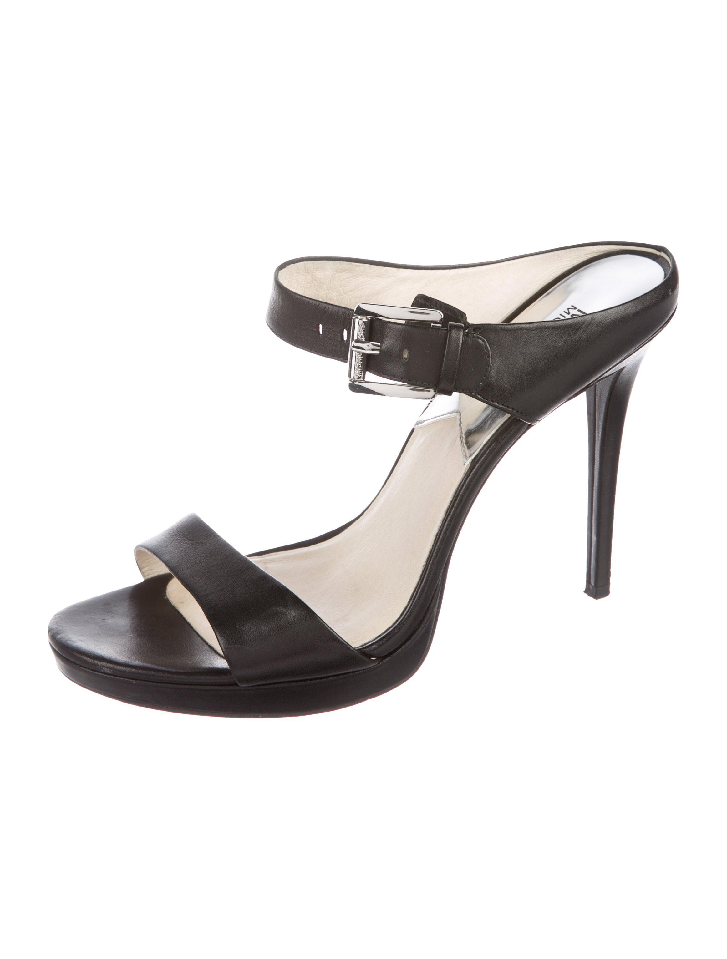 6a0d37a39db3 Black leather Michael Michael Kors ankle strap sandals with tonal stitching  and covered heels. Includes box.