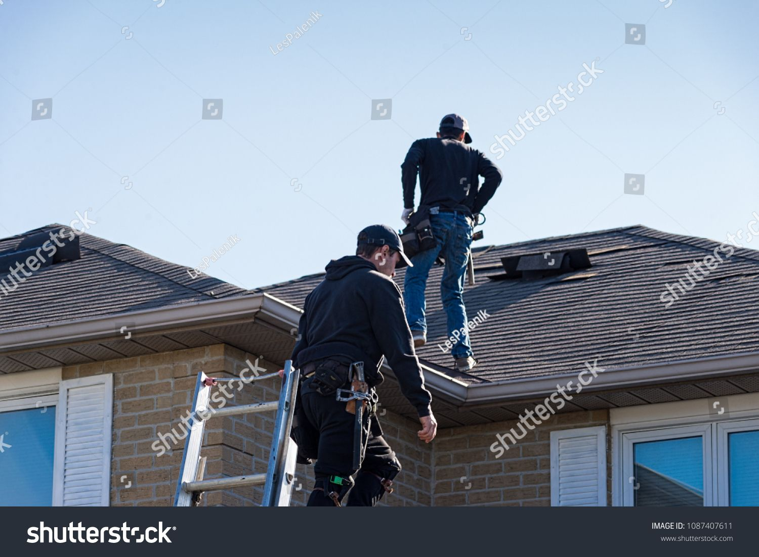 Two Roofers Inspecting A Damaged Roofinspecting Roofers Roof Damaged Cool Roof Roofing Services Roofing Contractors