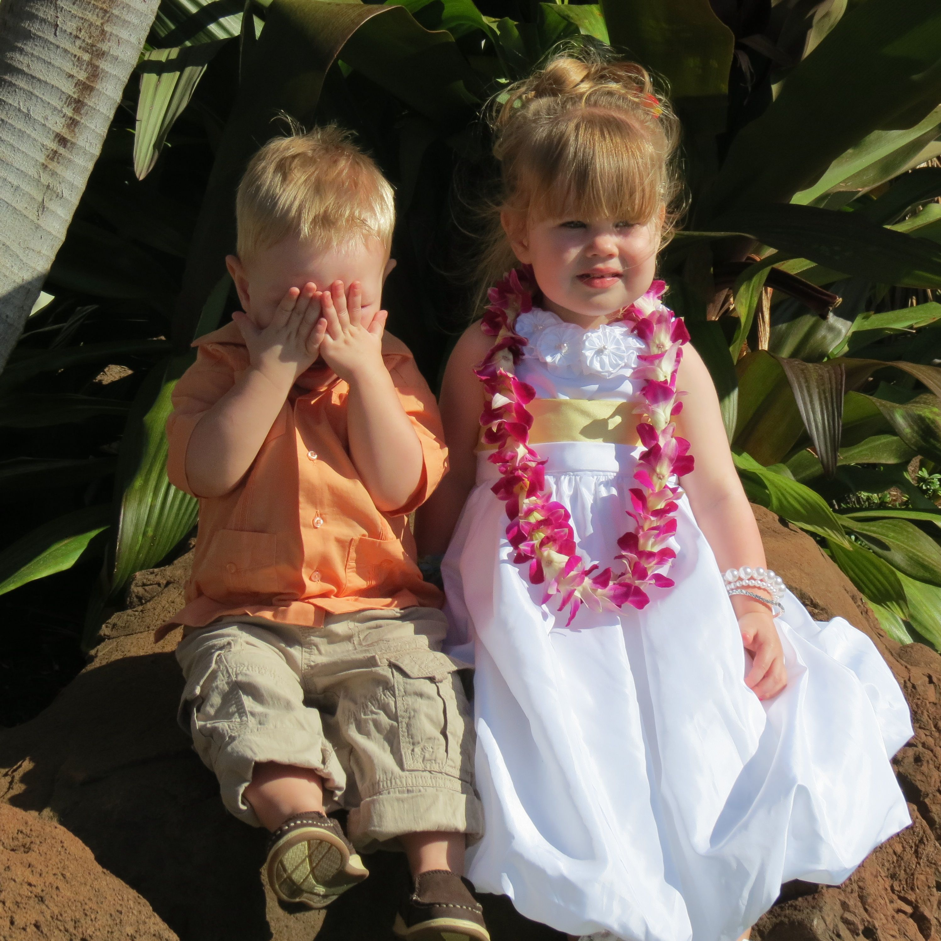 This shot is so cute of the flower girl and ring bearer at a destination wedding here on Maui, Hawaii. Photo by Kathy Tobin