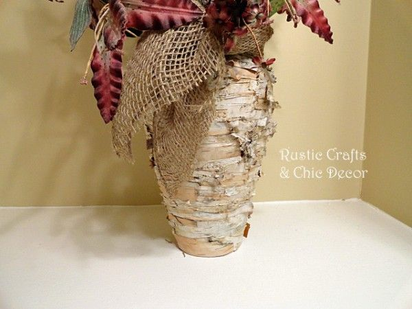 cover a plain glass florist vase with birch bark for a new rustic look