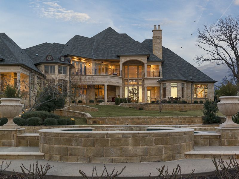 nestled on 28 acres of gated grounds this five bedroom stone masterpiece offers luxurious