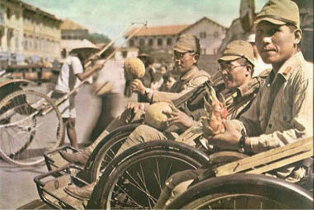 japanese soldiers of the 5th Infantry Division in the occupied city of saigon indochina, just before being departed to malaya in december 1941
