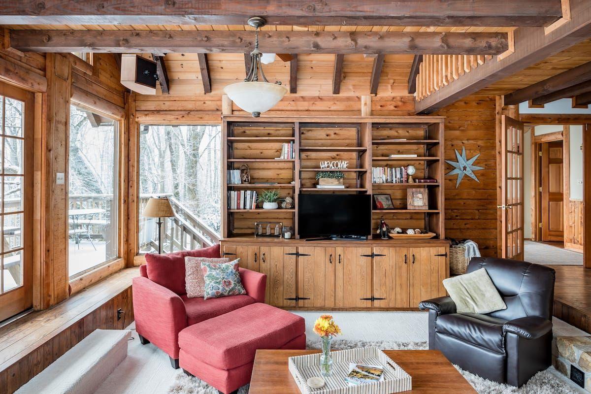 Captivating rusticchic log cabin views at otter falls