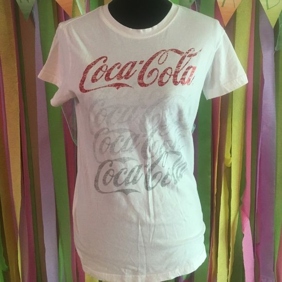 Coca Cola shirt white red silver Coca Cola shirt. Size states xl. Seems smaller. Juniors sizing. 100 percent cotton. Coca cola Tops Tees - Short Sleeve