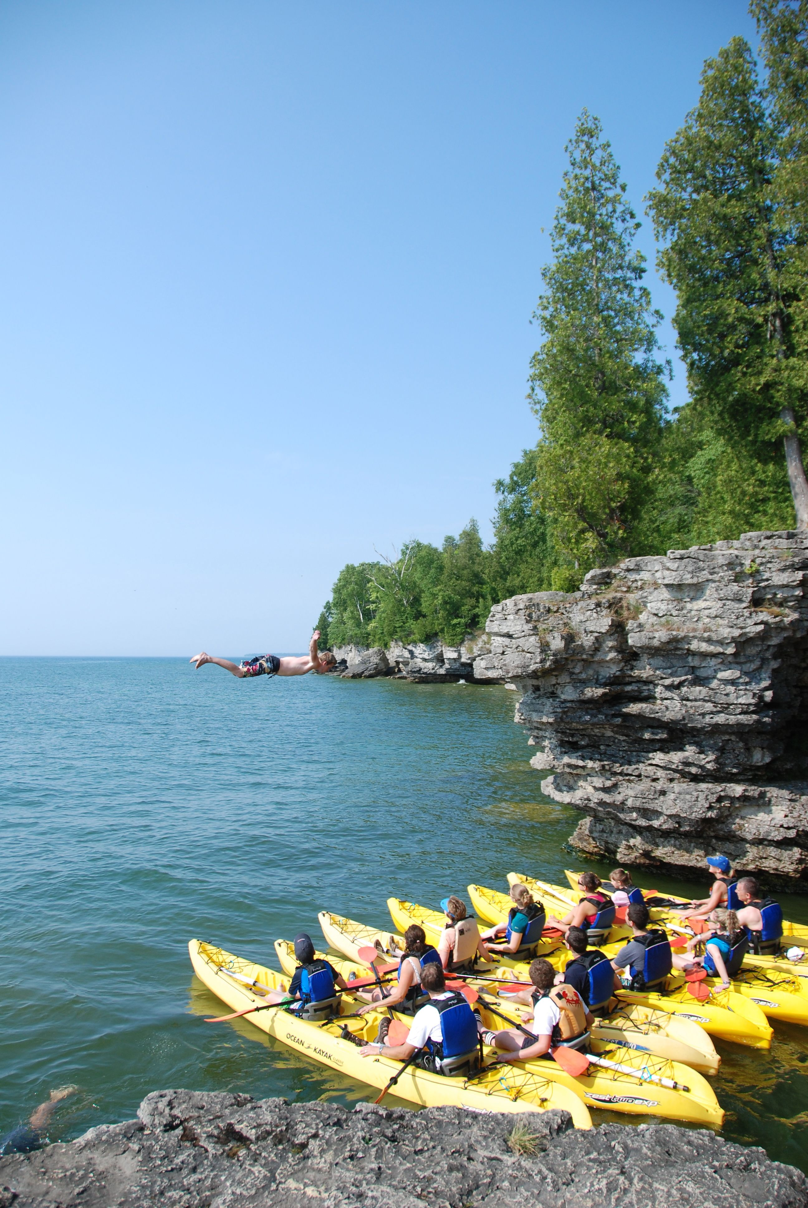 Guides are always goofing off and cliff jumping. Door County Kayak