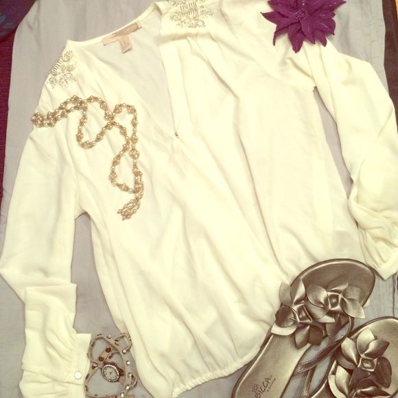 White Long Sleeve Blouse with Beaded Accent A lightweight blouse fit for any occasion featuring a button clasp in the front and beautiful beaded details on the shoulders, and a lightly gathered elastic waist trim. Roomy fit, can fit as both XS and S. Forever 21 Tops Blouses
