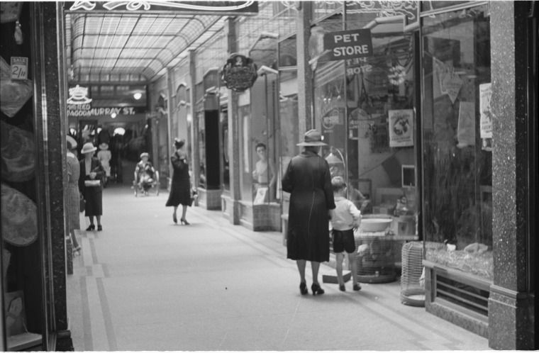 128374PD: Ahern's Arcade, from the Hay St end towards the Murray St exit, Perth, 1939. Kookaburra Pet Store at right https://encore.slwa.wa.gov.au/iii/encore/record/C__Rb3348178