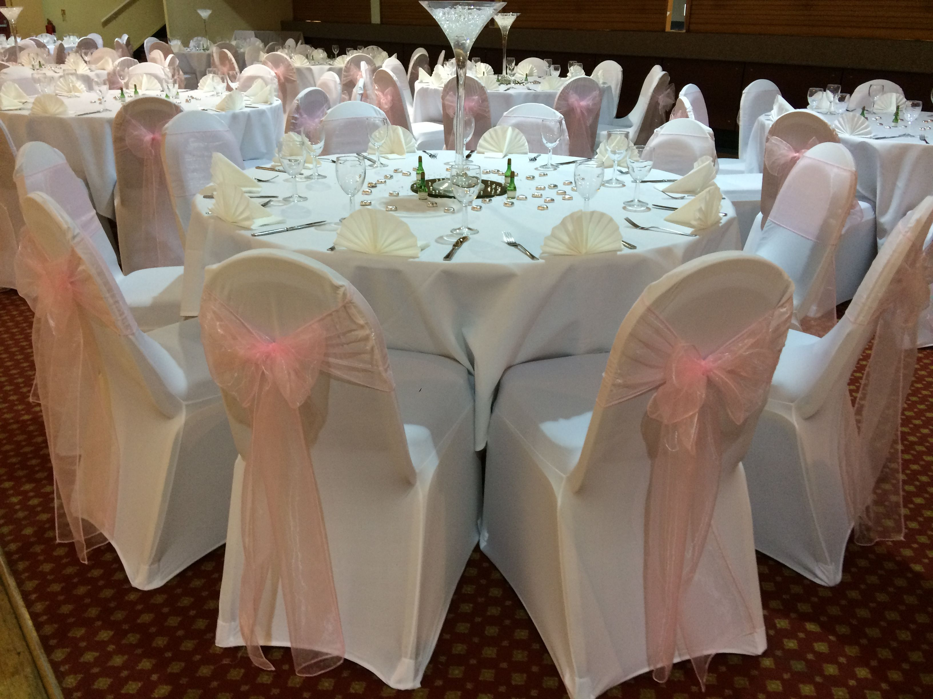 White Chair Covers With Pale Pink Organza Sashes At A Wedding At The Aberavon Beach Hotel Venue Dressed By Affinity Wedding Chair Sashes Wedding Hire Wedding