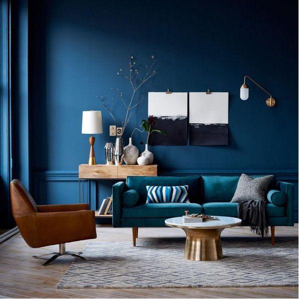 Deep Blue Walls And Teal Sofa With Warm Tones #blue #livingroom